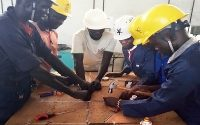 Vocational Students learning solar power installation